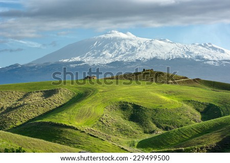 cultivated land and majestic of volcano Etna snow covered, Sicily - stock photo