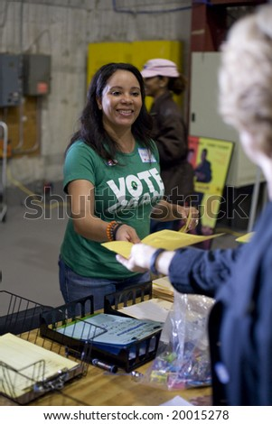 CULVER STUDIOS, CULVER CITY, CA - NOVEMBER 4 :  Campaign worker, Nikki Anderson, helps volunteers for the Barack Obama campaign for President of the United States make calls on Election Day. - stock photo
