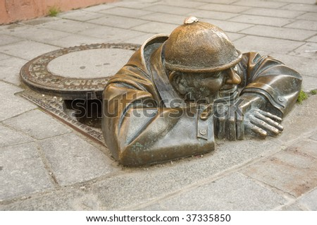 cumil - gazer - most photographer sculpture in Bratislava, capital city of Slovakia - stock photo
