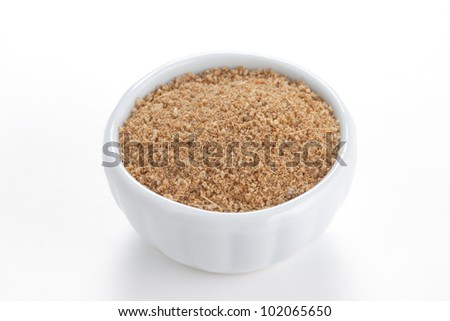 Cumin ground  in a white bowl on white background. Second most popular spice in the world after black pepper. - stock photo