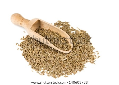Cumin seeds in a spoon for spices isolated on a white background - stock photo