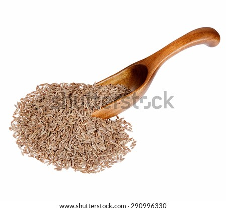 Cumin seeds in the wooden spoon, isolated on white background. - stock photo