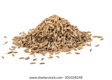 cumin seeds on the white background - stock photo