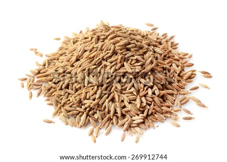 Cumin seeds on white background - stock photo