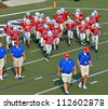 CUMMING, GA/USA - SEPTEMBER 8: A 7th grade football team and coaches on the field.  September 8, 2012 in Cumming GA. The Wildcats  vs The Mustangs. - stock photo