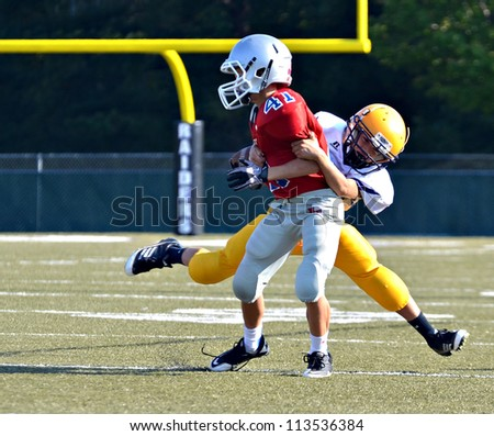 CUMMING, GA/USA - SEPTEMBER 22: Unidentified boys at the goal line during a football game. Two teams of 7th grade boys September 22, 2012 in Cumming GA. North Forsyth vs Lakeside - stock photo