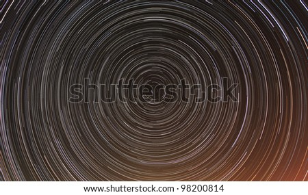 Cumulative time lapse of star trails in night sky. - stock photo
