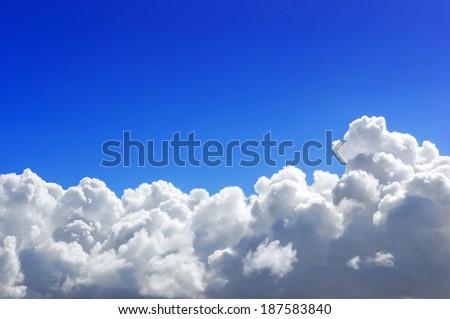 cumulonimbus stormy cloud with blue sky - stock photo