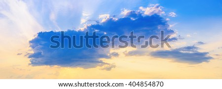 Cumulus cloud at sunset. Scenic sunset sky background. - stock photo