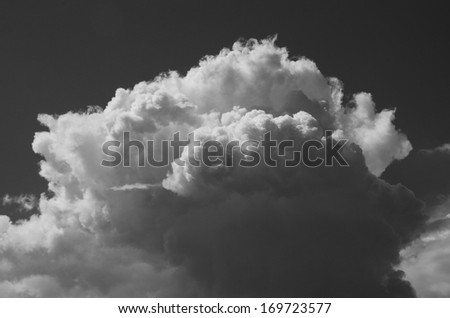 Cumulus cloud grows up and breadth, monochrome
