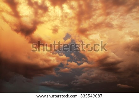 Cumulus clouds lit by sunset light