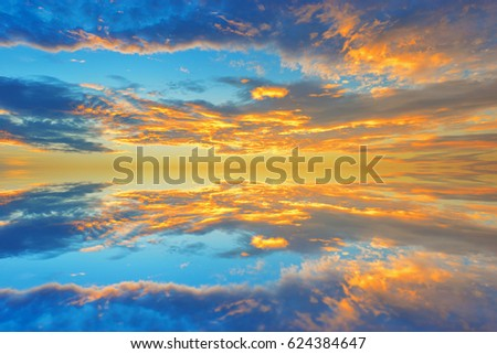 Cumulus sunset clouds with sun setting down,Clouds reflextion on during sunset