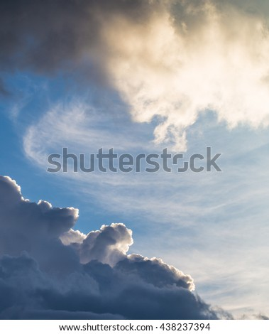 Cumulus sunset clouds with sun setting down, the beautiful sky - stock photo