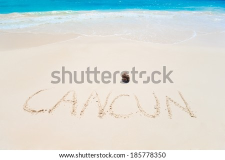 Cuncun sign on the beach of Caribbean Sea in Mexico  - stock photo