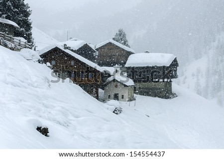 Cuneaz, Aosta Valley, Italy, Walser village with snow falling in winter