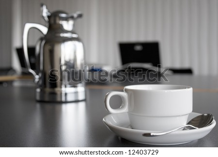 Cup and Coffee Pot on Desktop