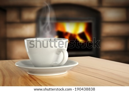cup and fire in fireplace  - stock photo