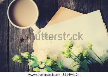 Cup and Letter with Message Love You, Light Green Roses to Valentine's Day on Wooden Table. Vintage Style - stock photo