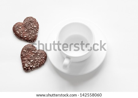 cup and saucer and a chocolate coconut cookies - stock photo