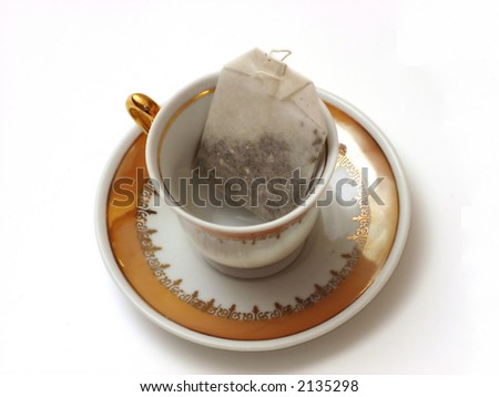 Cup and teabag - stock photo