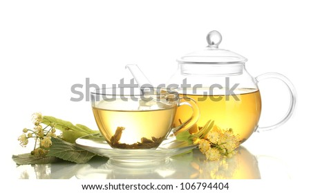 cup and teapot of linden tea and flowers isolated on white - stock photo