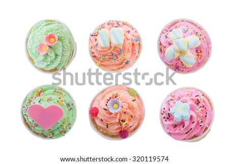 Cup cake and Candy sprinkles top view isolate on white background - stock photo
