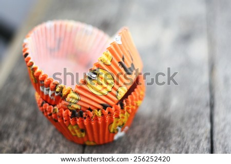 Cup cake cups with Halloween theme orange color.Selective focus, soft focus and shallow depth of fields - stock photo