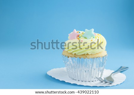 Cup cake with blue background - stock photo
