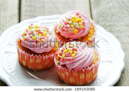 Cup cakes with frosting, selective focus - stock photo
