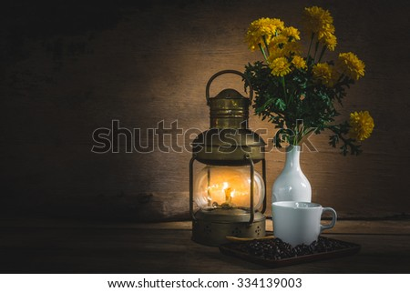 Cup coffee and beans on wooden table over grunge background