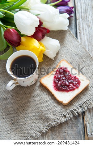 Cup coffee and flowers - stock photo