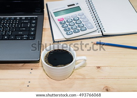 cup coffee and notebook on table background copy space / selective focus