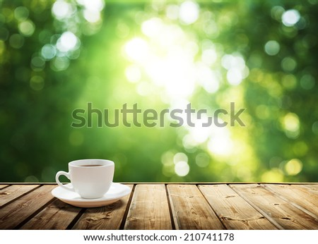 cup coffee and sunny trees background - stock photo