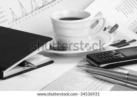 Cup  coffee on a morning paper business news - stock photo