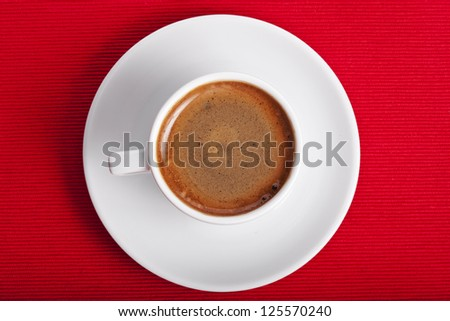 cup coffee on a red napkin background texture