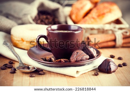 Cup coffee with beans and croissants - stock photo