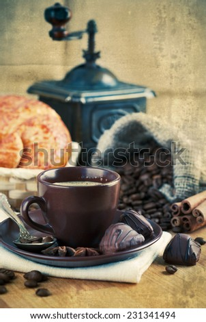 Cup coffee with grain and croissants - stock photo
