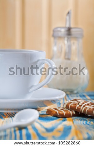 cup dispencer and cookies - stock photo