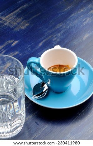 cup espresso with glass of water - stock photo