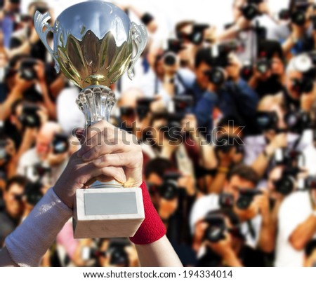 Cup for the first place in hands. - stock photo