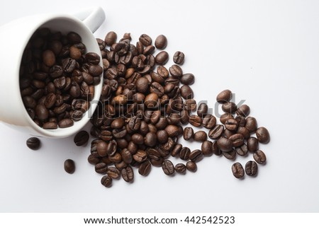 Cup full of coffee beans on the white background. used for background or material design. space for text