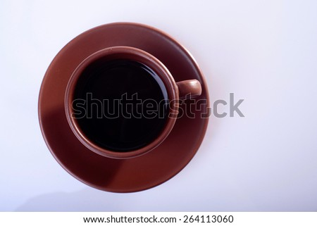 cup full of coffee on white background top view - stock photo