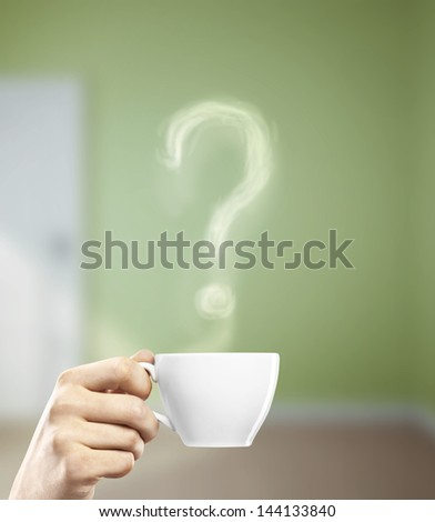 cup in hand with question mark - stock photo
