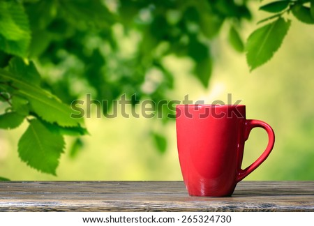 Cup in the garden - stock photo