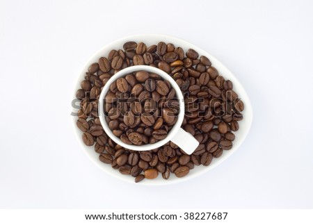 Cup inside coffee beans