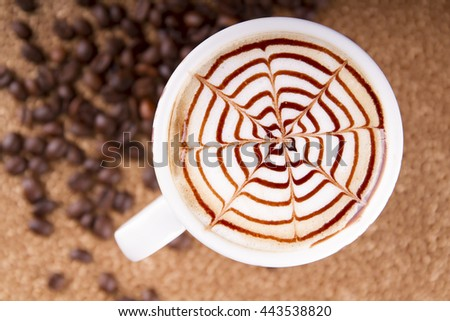 cup of a fresh caramel latte with whipped cream, top view  - stock photo