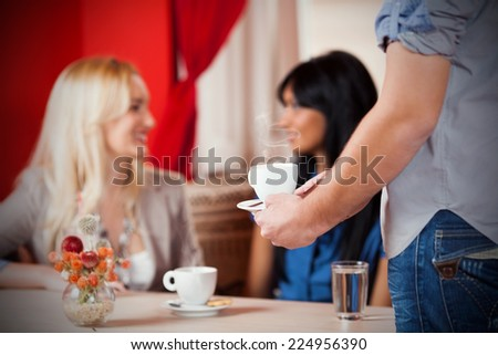 Cup of a hot drink with smoke coming up - stock photo