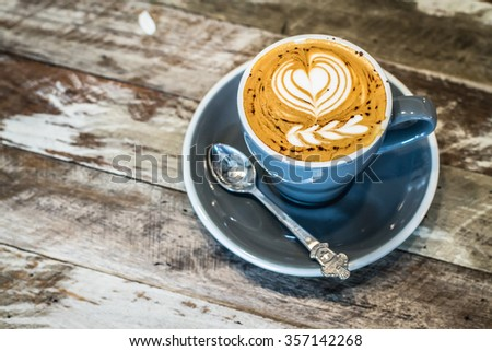 Cup of art cappuccino or latte or mocha coffee - stock photo