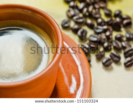 Cup of Black coffee and coffee beans on wooden table,selective focus. - stock photo