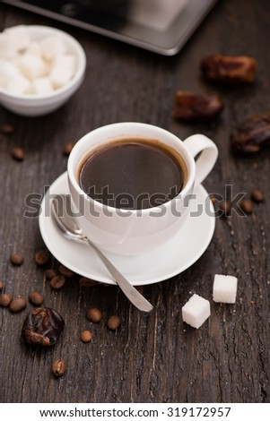 Cup of black coffee on the wooden table